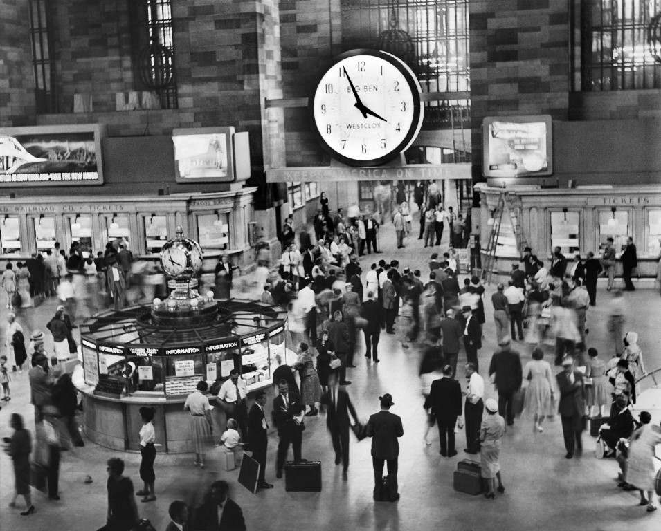 The clock over the south entrance to the main concourse at Grand Central Terminal, New York, in 1959. Built by Westclox, it is 15 feet in diameter and weighs three-quarters of a ton. It faces two ways. Amtrak will temporarily restore some intercity service to Grand Central Terminal to relieve pressure on the beleaguered Pennsylvania Station. (Arthur Brower/The New York Times)