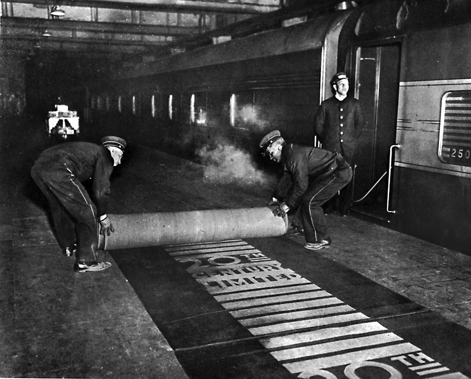 In an undated photo, workers rolling out the red carpet for passengers of the Twentieth Century Limited at Grand Central Terminal in New York. Amtrak will temporarily restore some intercity service to Grand Central Terminal to relieve pressure on the beleaguered Pennsylvania Station. (The New York Times)