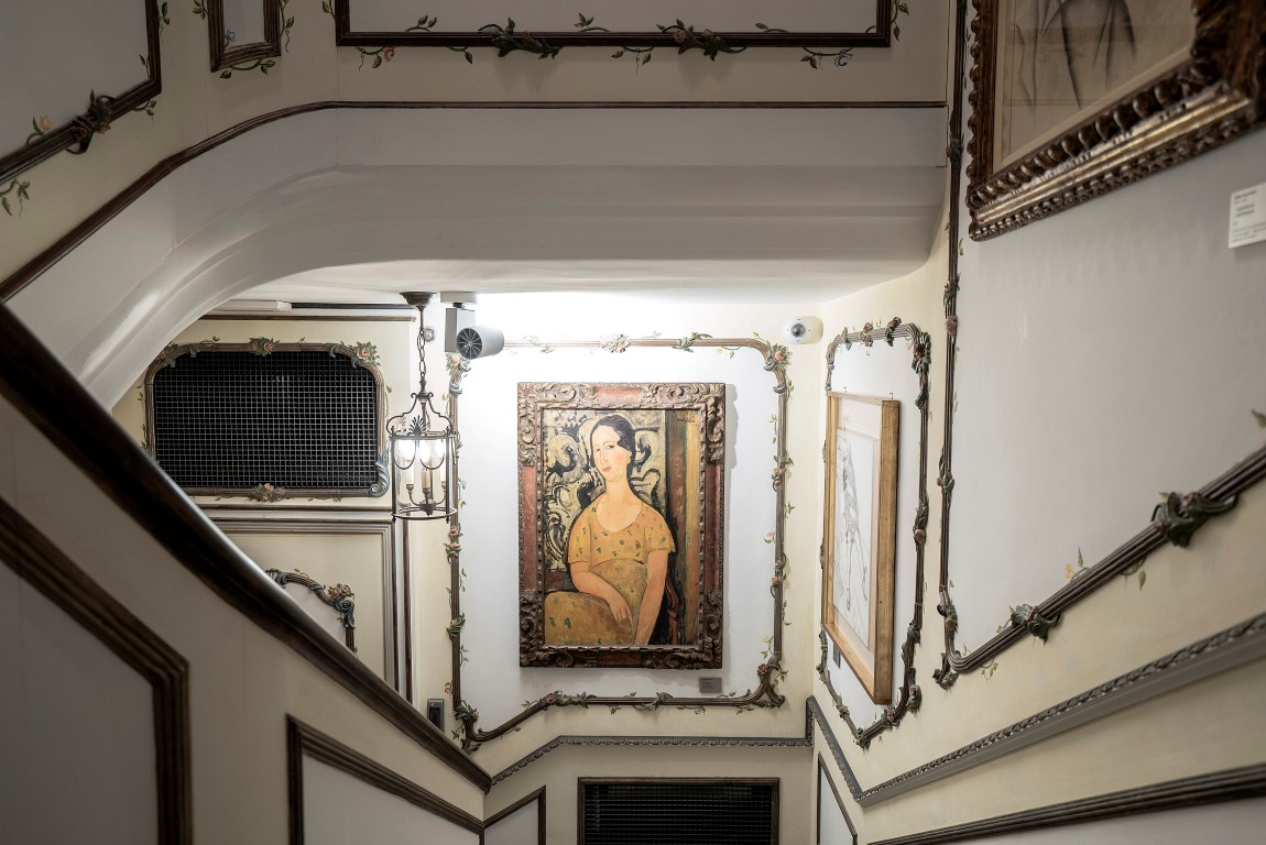 "Amedeo Modigliani's ""Woman in the Yellow Dress"" displayed on the staircase of Francesco Federico Cerruti's villa in Rivoli, Italy, May 1, 2019. Cerruti's collection consists of about 1,000 items displayed in the quirky Provençal-style villa he built in the 1960s. (Alessandro Grassani/The New York Times)"