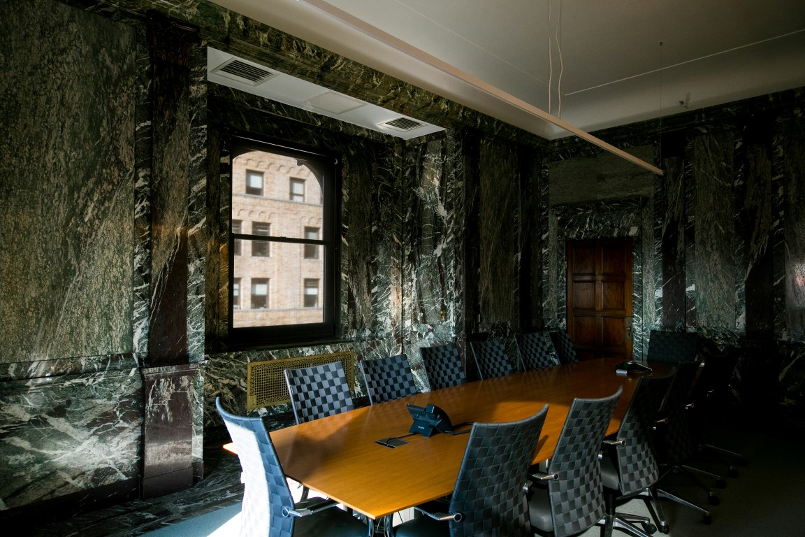 A conference room in marbled offices that once belonged to F.W. Woolworth, which architect Kang Chang restored for his firm Kang Modern, in New York, Aug. 9, 2019. Secret rooms are popping up in workplaces. (Jeenah Moon/The New York Times)
