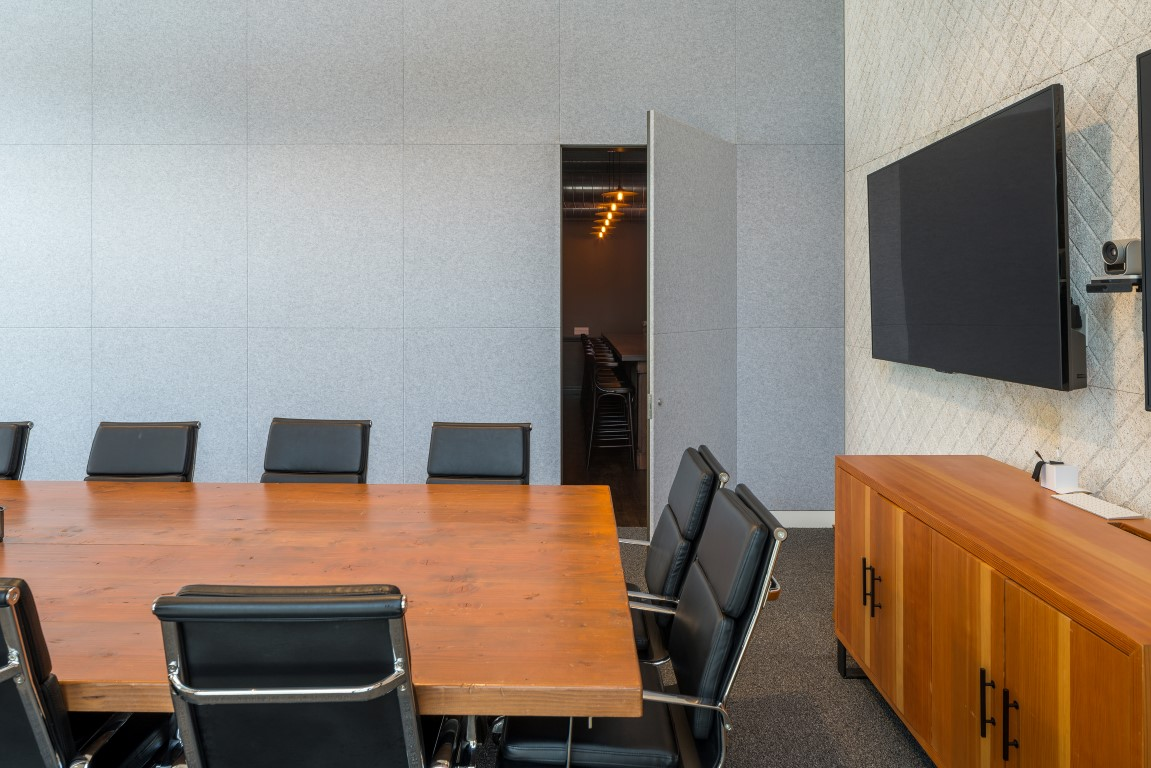 A hidden door in a conference room opens to reveal a speakeasy-style secret room at the advertising agency Deutsch in Los Angeles, Aug. 9, 2019. Secret rooms are popping up in workplaces. (Hunter Kerhart/The New York Times)