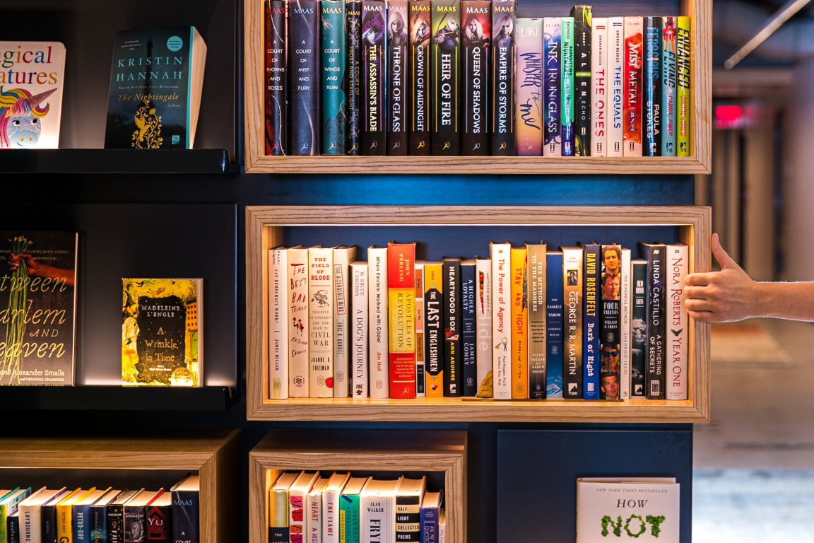 A wall with bookshelves pivots to reveal a secret green room at Macmillan Publishers in New York, Aug. 9, 2019. Secret rooms are popping up in workplaces. (Jeenah Moon/The New York Times)