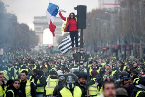 A protester wearing yellow vest, a symbol of a French drivers' protest against higher fuel prices, stands on the red light on the Champs-Elysee in Paris, France, November 24, 2018. REUTERS/Benoit Tessier     TPX IMAGES OF THE DAY