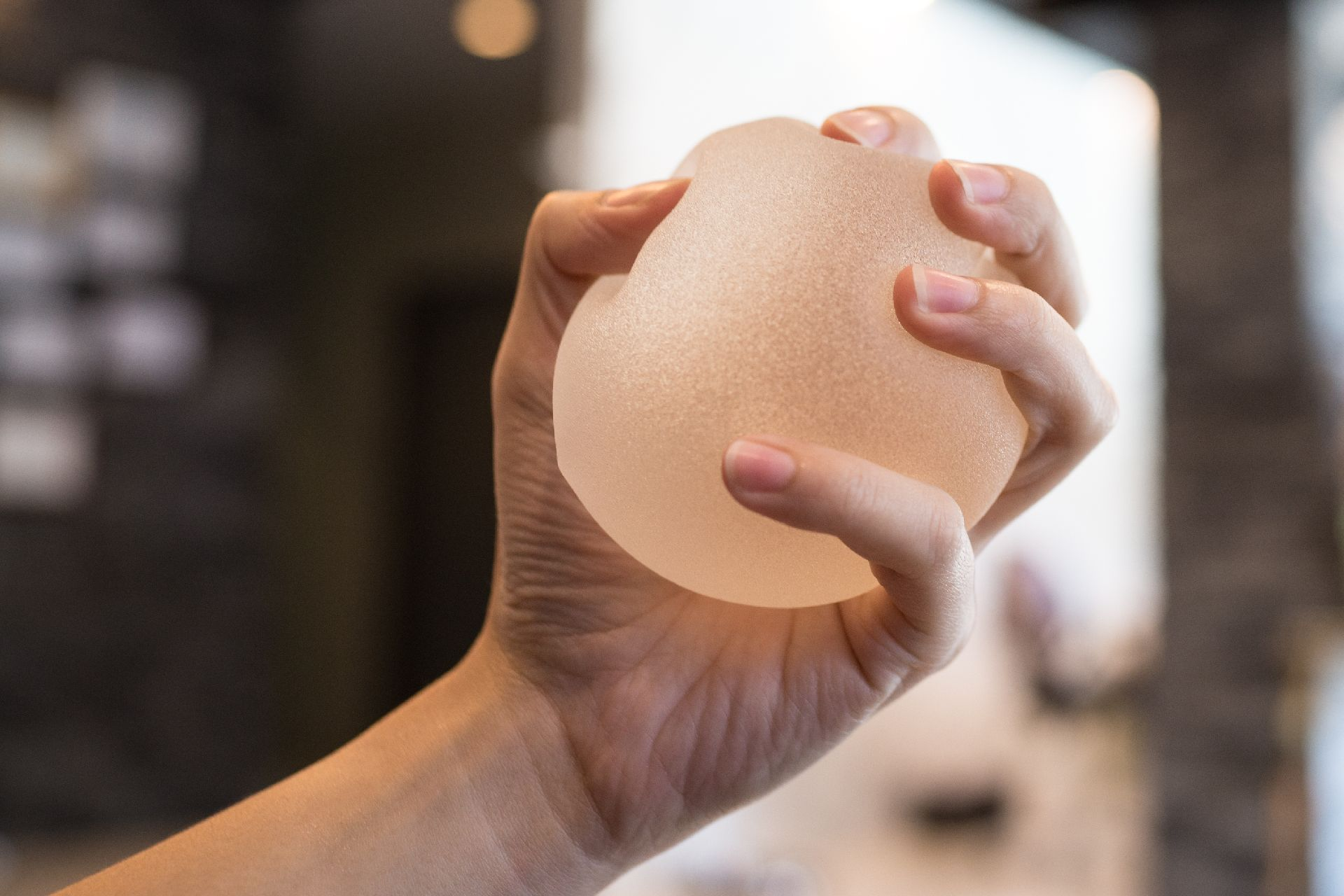 Close up Silicone breast implant on hands