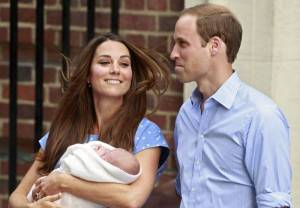 Britain's Prince William and his wife Catherine, Duchess of Cambridge appear with their baby son, outside the Lindo Wing of St Mary's Hospital, in central London